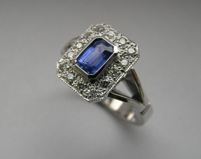 Emerald cut sapphire and diamond antique style ring