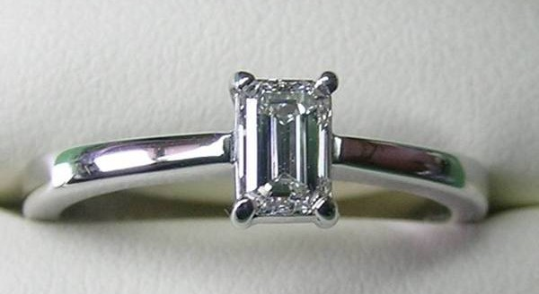 Solitaire emerald cut diamond engagement ring