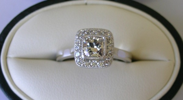 Platinum cushion cut diamond halo engagement ring