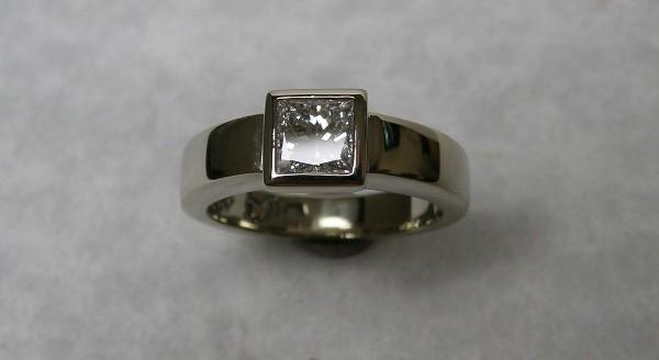 Solitaire bezel set princess cut diamond engagement ring