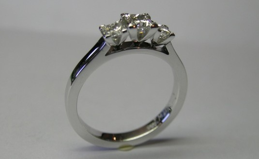 Three princess cut diamond engagement ring
