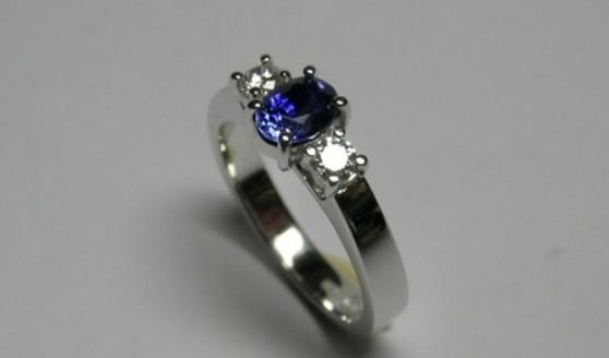 Oval Ceylon sapphire and diamond engagement ring