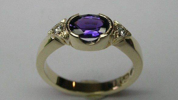Natural purple sapphire and diamond dress ring