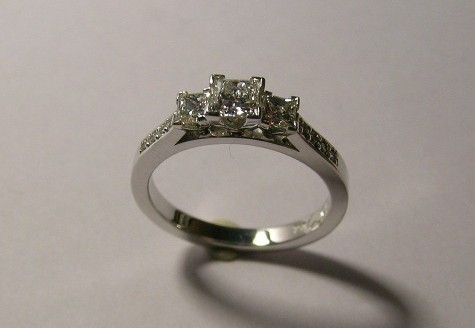 Three princess diamond engagement ring