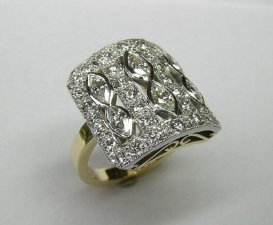 Antique style marquise and brilliant cut diamond dress ring