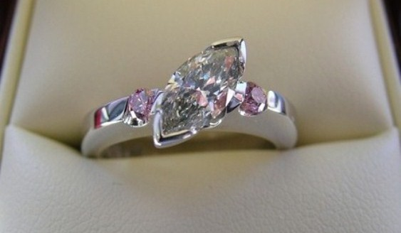 Unique marquise and pink diamond engagement ring