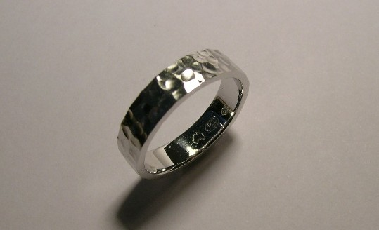 Contemporary gents platinum wedding ring with hammered finish