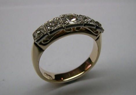 Five diamond antique style ladies occasion ring
