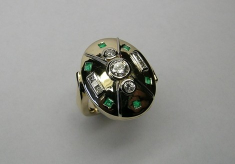 Emerald and diamond ladies dress ring