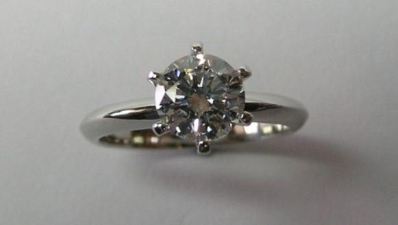 Elegant platinum solitaire diamond engagement ring