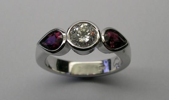 Brilliant cut diamond and pear shaped rubies dress ring