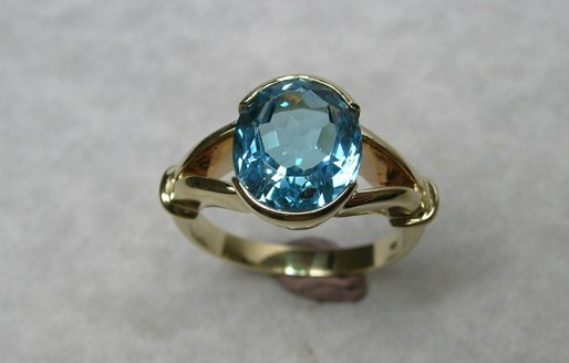 Oval natural blue topaz dress ring