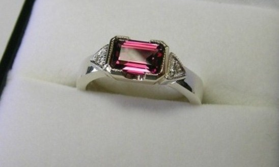 Emerald cut rhodolite garnet and diamond dress ring