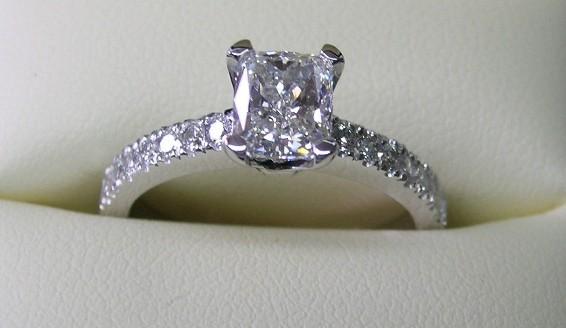 Stunning platinum cushion cut diamond engagement ring