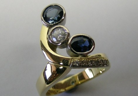 Contemporary style sapphire and diamond ladies ring