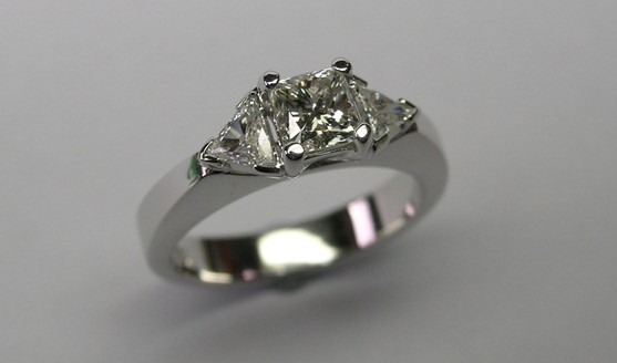 Radiant and trilliant cut diamond engagement ring