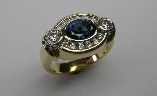 Oval sapphire and diamond ladies dress ring