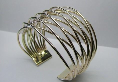 Contemporary style gold cuff bangle