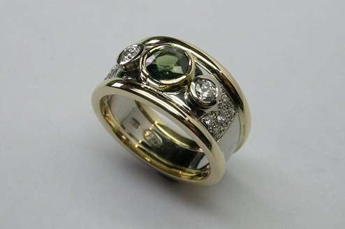 Lustrous contemporary style green sapphire and diamond dress ring