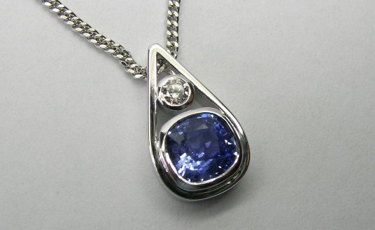 Stylish cushion cut Ceylon sapphire and diamond pendant