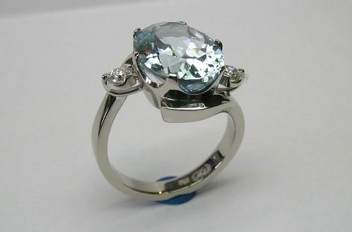 Oval aquamarine and diamond ladies dress ring
