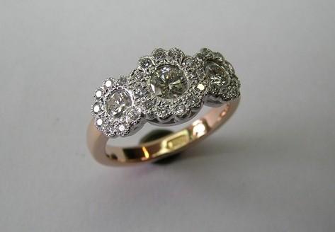 Antique style flower design three brilliant cut diamond dress ring