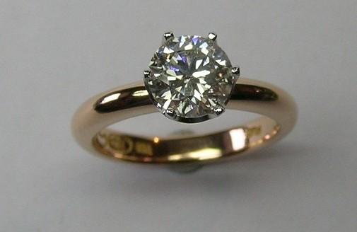 Platinum and rose gold solitaire round brilliant cut diamond ring