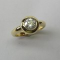 Bezel set solitaire round brilliant cut diamond dress ring