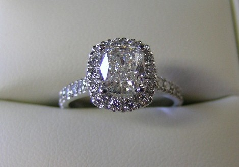 Cushion cut diamond  halo design engagement ring