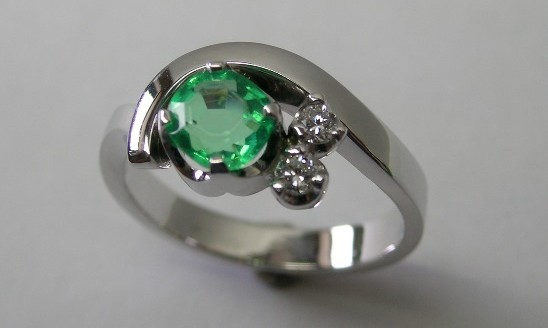 Natural emerald and diamond ladies dress ring