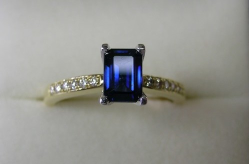 Emerald cut Australian sapphire and diamond engagement ring
