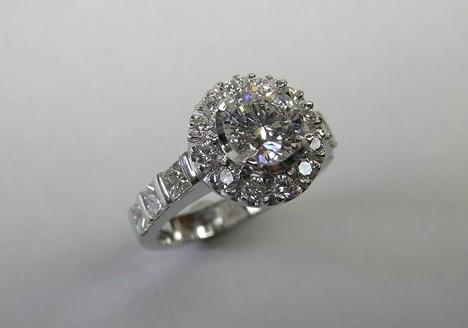 Platinum round brilliant and princess cut diamond halo engagement ring