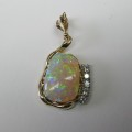 Solid opal and diamond pendant