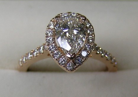 Pear shaped diamond rose gold halo engagement ring