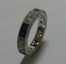 Vintage design sapphire and diamond platinum anniversary ring